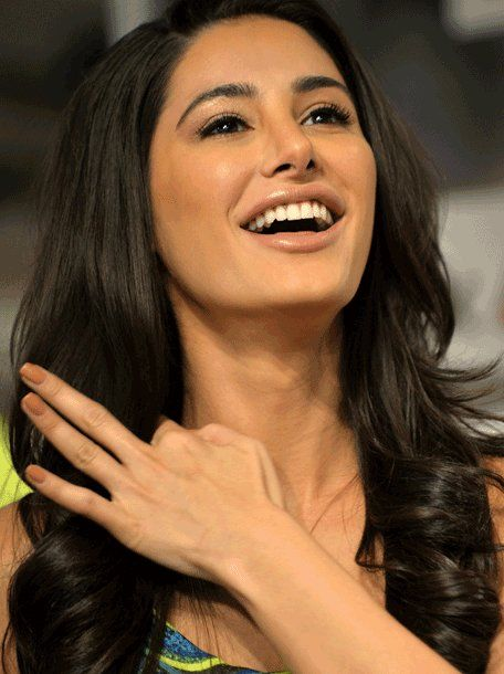 Make your nerves to the brain energetic by doing this hand sign. Nargis Fakhri. Credit:  emirates247.com