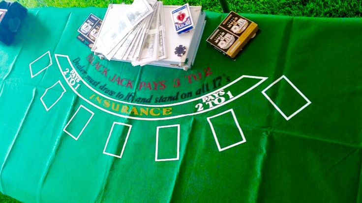 Black jack felt table top and funny money found at local party store for 25th casino themed birthday party. Card packs and poker set found at Walmart.
