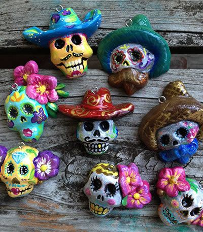 8 hand painted clay sugar skull ornaments made from MexicanSugarSkull.com chocolate skull molds