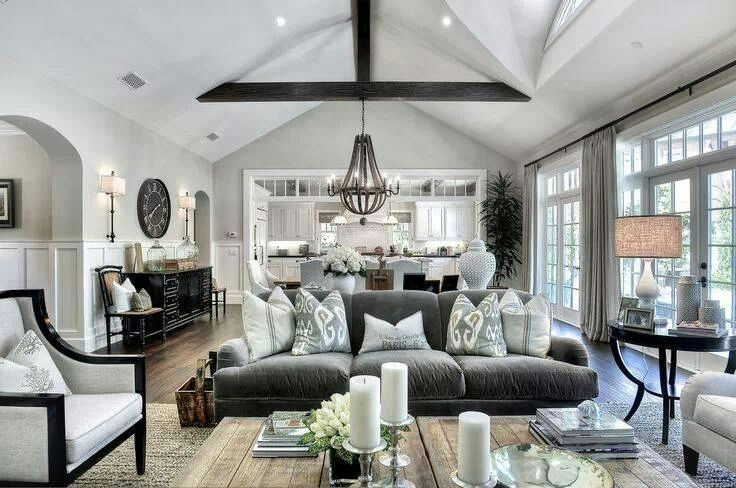 I love this living room | fabulous architecture, French Doors, mouldings | pale neutral colors | English roll arm sofa | great styling | modern traditional | neo-tradtional