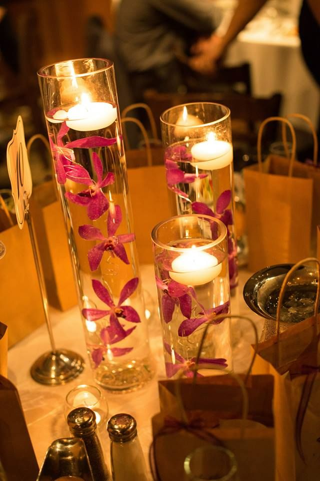 floating candle centerpiece with submerged orchids #wedding