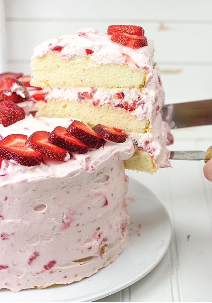 "Fresh Strawberry Cake – Packed with fresh berries and topped with a light whipped cream frosting, nothing says ""summer"" quite like this dessert!"