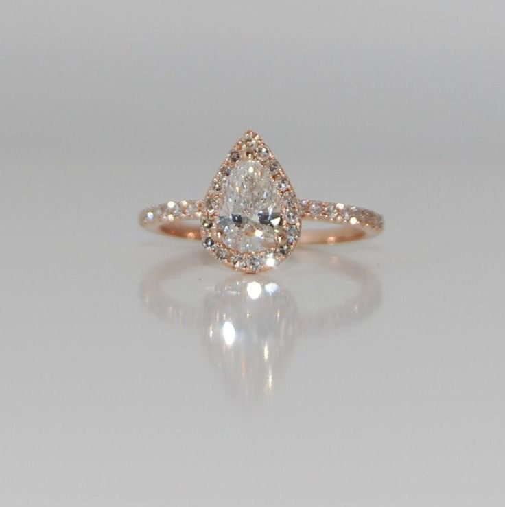 0.84 White D/SI2 Diamond Rain drop pear 14k rose gold ring engagement ring. $3,000.00, via Etsy.