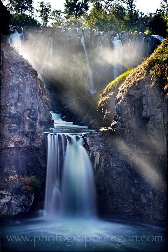 www.photographeroregon.com: White River Falls, located just east of Tygh Valley along Hwy 216 near Maupin, Oregon.  In the spring it is one wide waterfall; in late summer and fall it is about 6 smaller falls.  The photographer took this image around 5:30pm on Sept 10 to get the sunbeams through the mist
