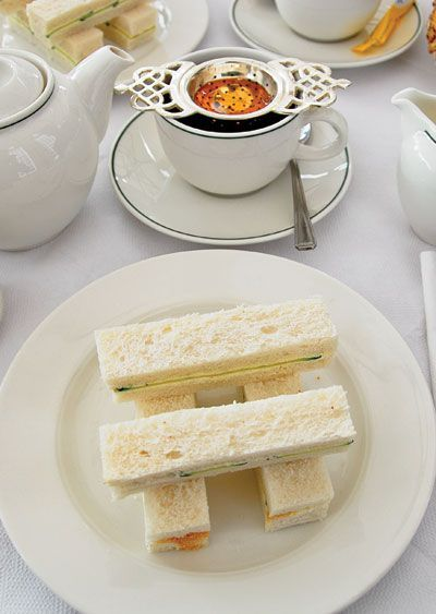 The History of Tea Sandwiches | Ever wonder who came up with the delicious tiny sandwiches we serve with tea? Find out about it in this classy article!