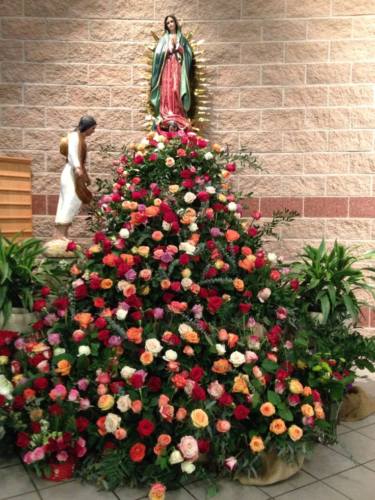 Our Lady of Guadalupe altar arrangement, cascading flowers, 400 roses, 6 bunch fern, 6 bunch salal, 2 ruscus, 2 eucalyptus, 2 seeded eucalyptus. 11 rectangle arrangements 5 levels. 3-3-2-2-1. Our lady statue on a box