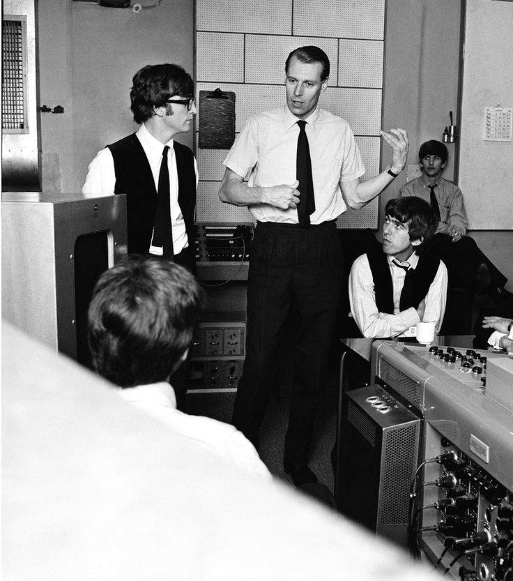 Sir George Martin with the Beatles - studio equipment resembling washing machines!