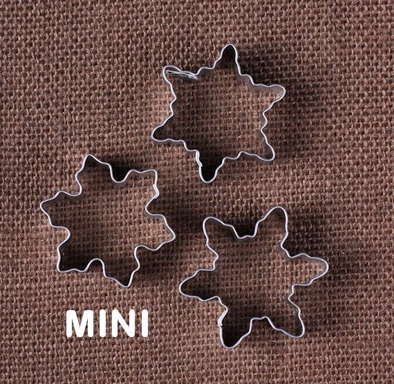Use our mini snowflake cookie cutters for making tiny sugar cookies! This set comes with three mini snowflakes. These are very little so they are perfect to use for cutting out pie crust for decorativ