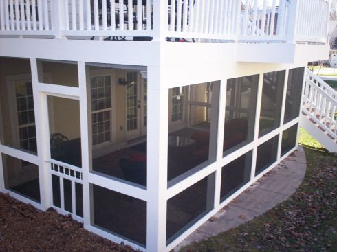 Two Story Deck in St. Louis with Screens and Underdeck.  How about a screened in porch underneath?  Too dark?