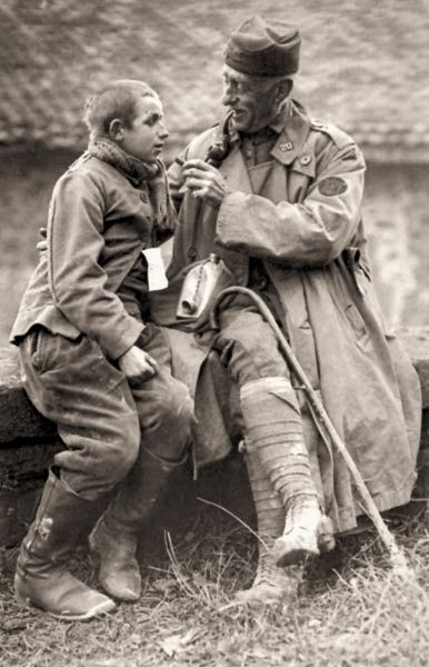 A US army chaplain and a young German POW, 1918 - He is but a boy fighting a man's war
