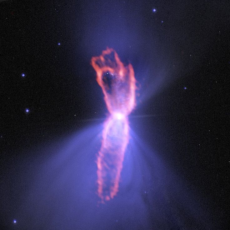 True shape of the Boomerang This image shows the Boomerang Nebula, a protoplanetary nebula, as seen by the Atacama Large Millimeter/submillimeter Array (ALMA). The background purple structure, as seen in visible light with the NASA/ESA Hubble Space...