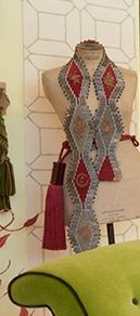 An unusual length of bugle-beaded embroidery hung on a vintage mannequin.