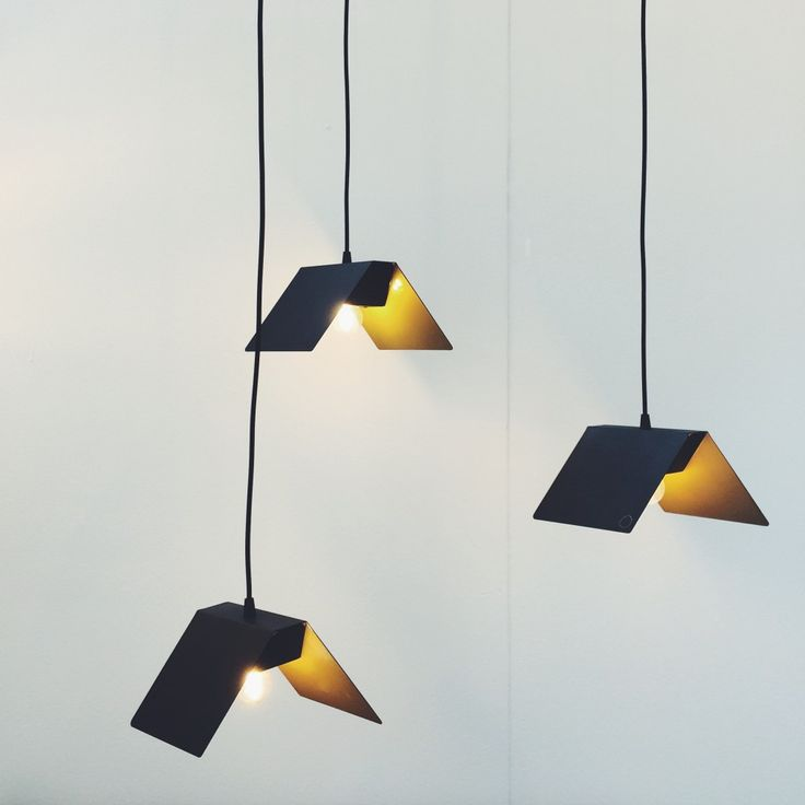 Strikingly simple but ever so beautiful Brass and black pendant light by Papillon through Bright Potato. Design Junction & Tent London 2015 | Design Soda : Interiors Blog