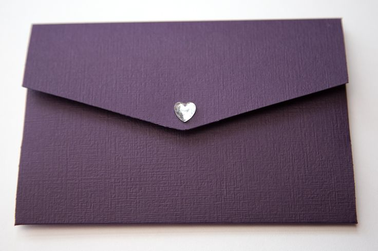 Plum pocketfold Invitation with diamante heart The wallet is made from luxurious plum linen card complete and velcro fasteners Inside there will be a white insert attached containing the details of your special day decorate with silver double border. In the pocket there will be two card inserts which can contain information for your guests such as RSVP details, maps, accomodation or gift list Size 148mm x 105mm They come complete with white envelopes Other coloured card or designs are…