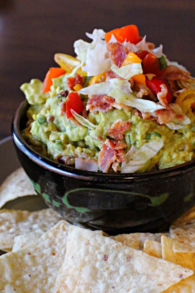Spicy Guacamole Recipe With Bacon Lettuce And Tomato Served In A Brown Handmade Pottery Dish With Best Guacamole Recipe Spicy Guacamole Basic Guacamole Recipe