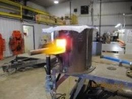 Propane Forge - Homemade propane-fired forge fabricated from steel pipe and pipe fittings. Air is supplied by a blower.