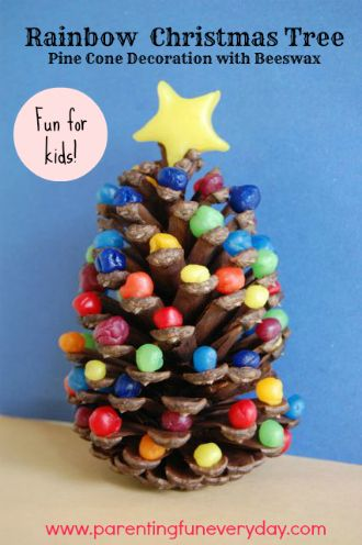 Try this easy christmas craft for kids to make- a rainbow beeswax-covered pine cone 'Christmas Tree'  FUN! www.parentingfuneveryday.com PS: This is no. 4 in the 30 days of Christmas crafts series. Pop over to the blog to see heaps of other fun ideas