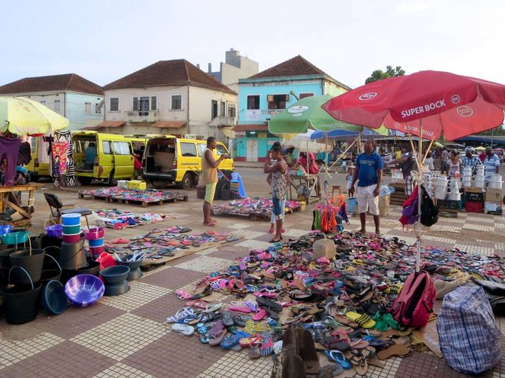 Rubber sandal merchants spread their wares on Praca Yon Gato near the main markets in Sao Tome, São Tomé and Príncipe.