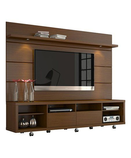 This TV stand comes with a panel featuring mounting hardware to hang your 70 inch flat screen television and complete your entertainment center using the roomy cubbies, drawers and shelves.