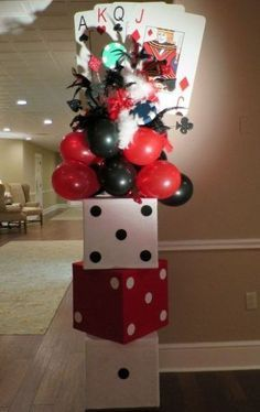 Clever casino themed 50th birthday balloon decorating idea.  See more 50th birthday party themes and party ideas at www.one-stop-party-ideas.com