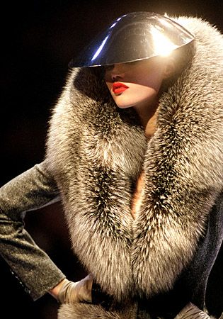 A metallic helmet adds flair to a fur coat designed by McQueen for Givenchy's ready-to-wear fall/winter 1998-99 show in Paris.