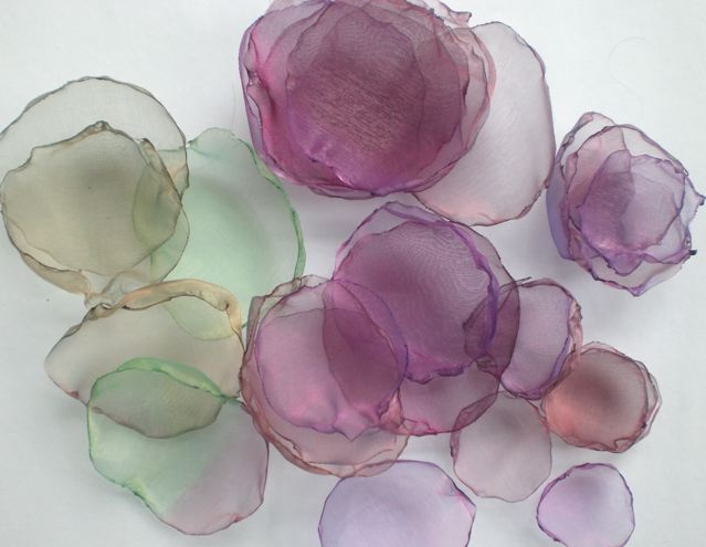 organza flowers for decorating anything. Hair, tables, guests, haha. These are so pretty!