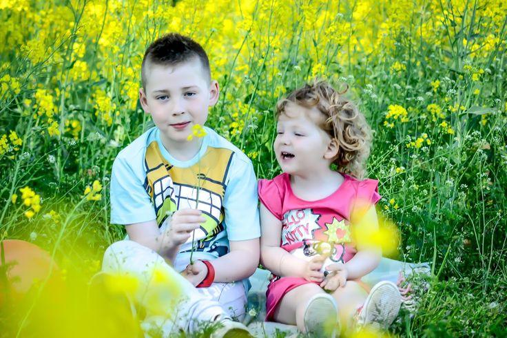 Children in the field of oilseed rape flowers