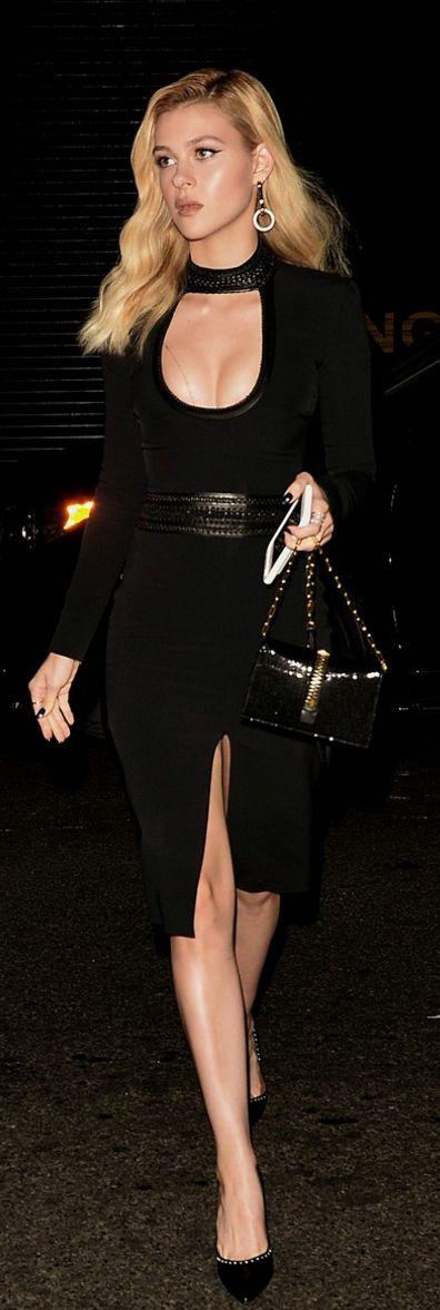 Who made Nicola Peltz's black dress, sequin bag, and pumps?