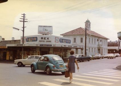 Taken in 1973, this image features Forest Road at MacMahon Street a few years before the corner was re-developed. The Rex Coffee Lounge and the former Council Chambers beside it were shortly after demolished to make way for Hurstville House.
