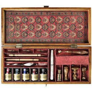 Sit right down and write a letter with this authentic World War I era design, French style pen nibs and ink writing kit. Designed after the implements used to sign the historic Treaty of Trianon in 1920, this fully-functional set features a colorful variety of inks, styluses, nibs, sealing wax, sealing tools, and brass and wood seals. A writer's dream in a French honey finish box with solid brass hardware, lined with antique pattern paper. $109.