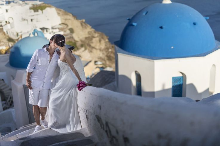 Santorini is the place to be for simply stunning backdrops and scenery for wedding photos. Of course, you can choose here for your honeymoon place.