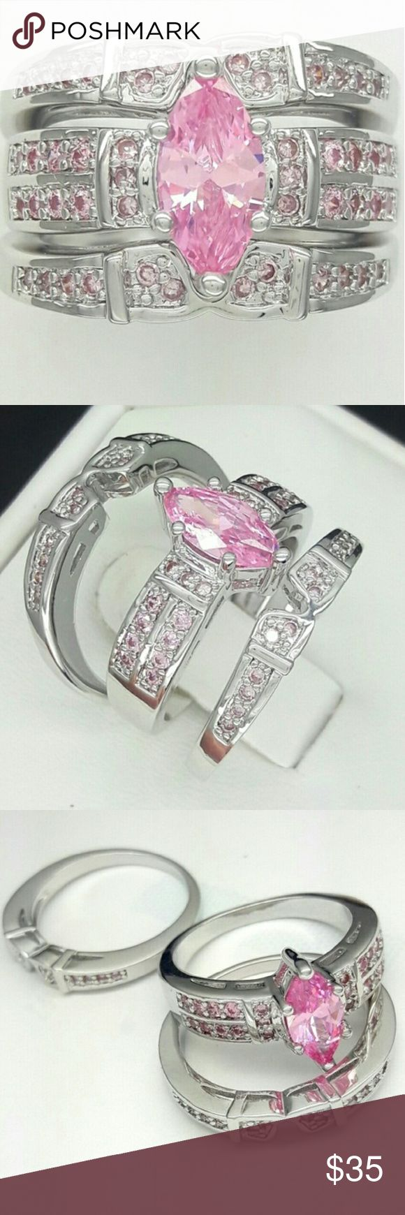 NWOT 1.3 Karat Marquise Cut Size 7 A beautiful set that will surely turns heads. A gorgeous pink cz that is beautiful. 1.3 Karat. Silver plated. Jewelry Rings