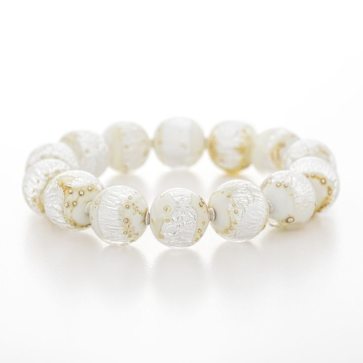 From the Muskoka Silver Birch collection this bracelet features white colored glass with fine silver embedded within it and a bit of fine silver wire melted in on the surface