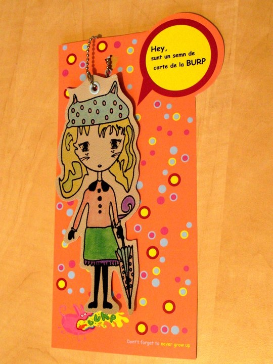 This is a (leather) bookmark. Her name is Cat-Girl and she is a fine lady, trained in the good-ol' Mary Poppins style.