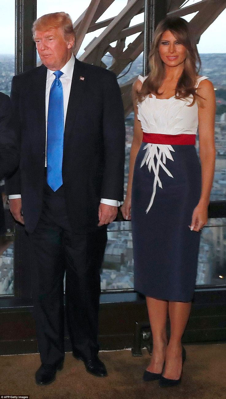 In a nod to the national flags of France and the United States,' First Lady Melania Trump ... President Donald Trump and First Lady Melania (red, white blue dress) dine with French President and wife in the Eiffel Tower. July 13 2017