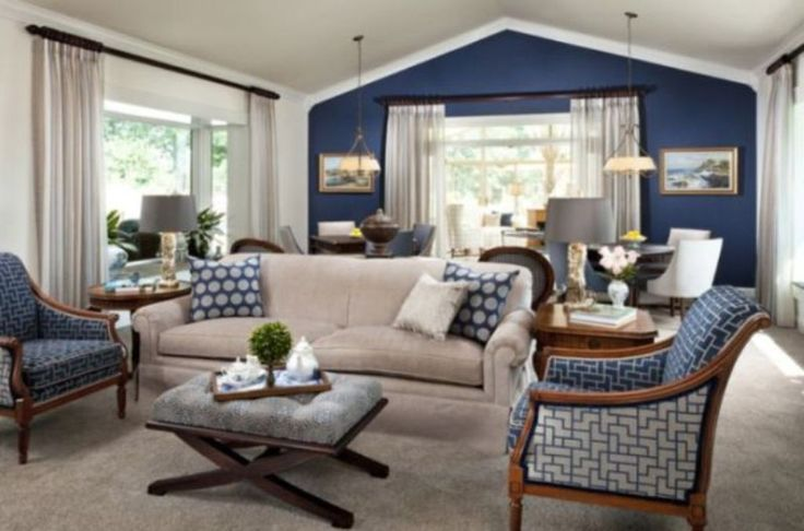Stylish vaulted ceiling with dark blue accent wall for - Navy blue and turquoise living room ...