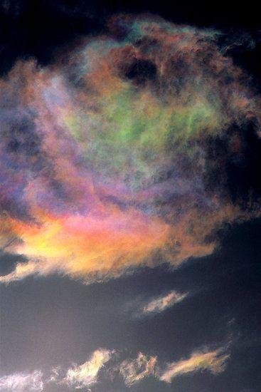 Iridescent Cumulus cloud near Melbourne, Victoria. by Ern Mainka