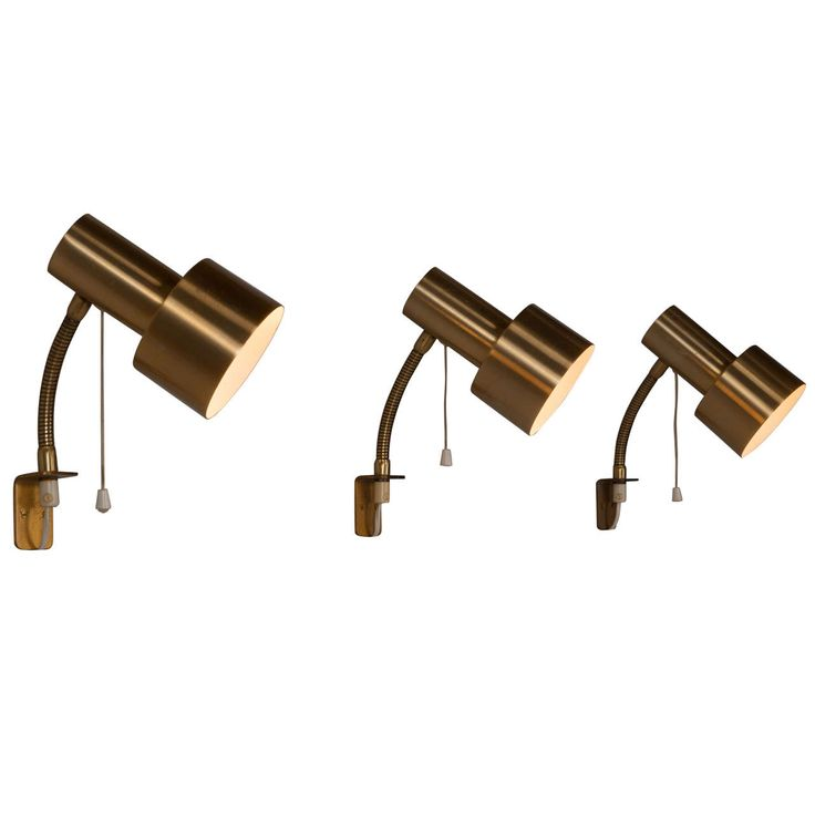 Set of fourteen adjustable brass wall lights | From a unique collection of antique and modern wall lights and sconces at https://www.1stdibs.com/furniture/lighting/sconces-wall-lights/