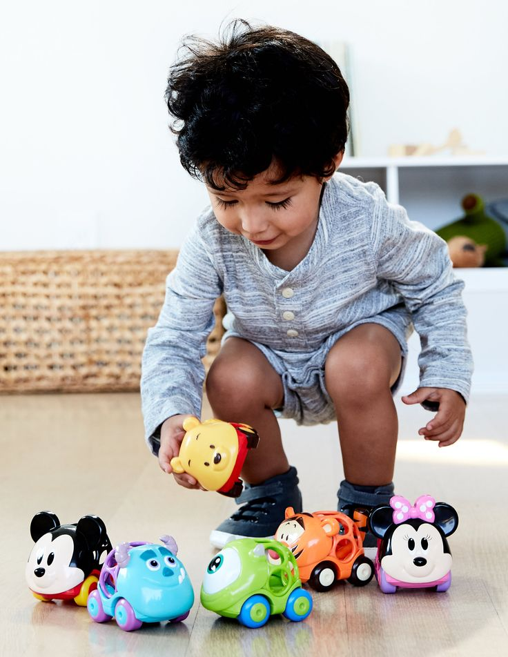 The Go Grippers Collection is a set of 6 fun Disney character cars: Mickey Mouse, Minnie Mouse, Winnie the Pooh, Tigger, Sulley, & Mike Wazowski. The easy-to-grasp signature Ball design makes these cars easy for little fingers to pick up and play. The cars roll easily and interact with all Ball Go Grippers toys and play sets. These Disney themed cars are rugged and ready for playtime. Great toy for on-the-go, and a great holiday gift for baby. #DisneyBaby