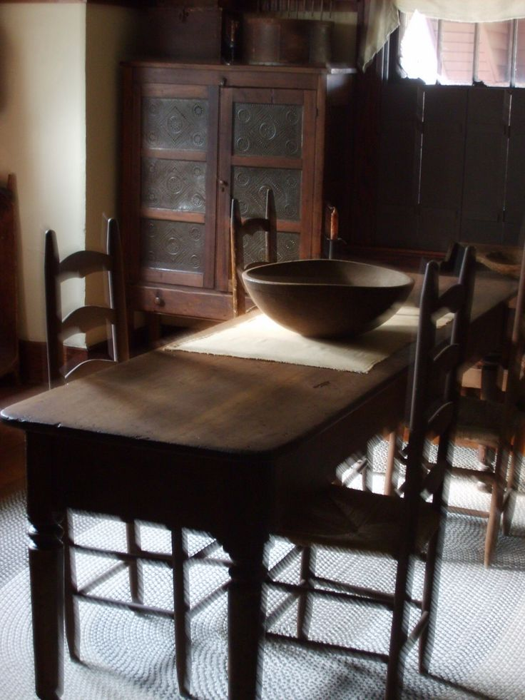 love the old farm table with ladder back chairs and the pie safe tucked into - Primitive Kitchen Tables