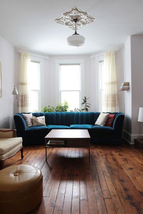 velvet sofa + ornate ceiling medallion