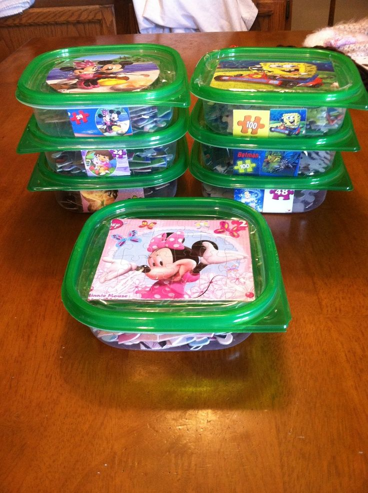 Use dollar store containers to keep kids puzzles organized. Tape picture to lid and a smaller picture on side. Easy to stack and see which puzzle they want.