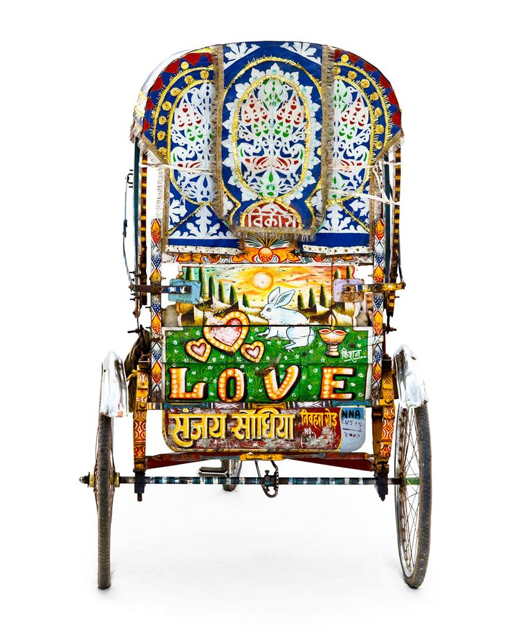 allahabad rickshaws are typically painted wood whereas their counterparts in other cities are covered in