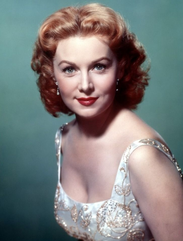 """Rhonda Fleming, American film and television actress, nicknamed the """"Queen of Technicolor"""" in the 1940s and 1950s, because her fair complexion and flaming red hair had a vibrant appearance in Technicolor"""