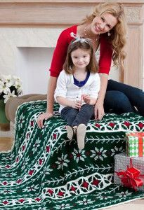 The Vintage Crochet Poinsettia Throw is the perfect Christmas crochet afghan to cuddle with while watching classic Christmas movies. | AllFreeCrochetAfghanPatterns.com