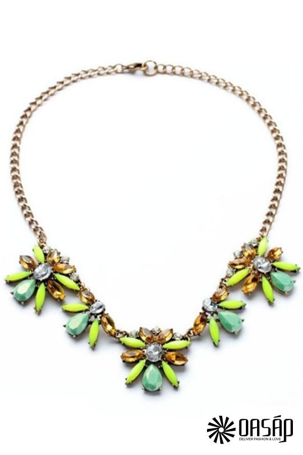 The bib necklace featuring faux stone partern. Rolo chain with beaded detail. Adjustable clasp.