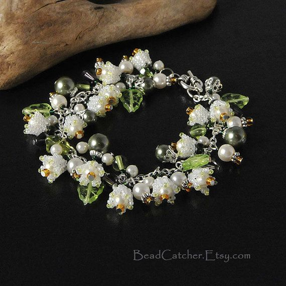 Spring bracelet made with tiny bead woven Lily-of-the-valley flowers, pearls, glass peridot leaves. Tiny flowers are made with smallest available glass seed beads from Japan in pearly white color.