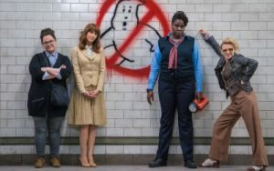 The female cast of Ghostbusters with the movie's logo -Melissa McCarthy, Kristen…