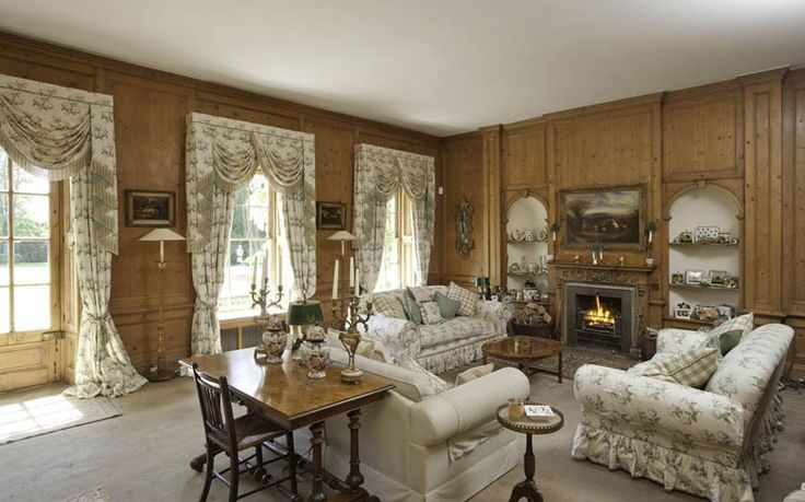 The pitch pine pannelled drawingroom of the former country home of the late Sir David Frost.The curtains etc are Colefax and Fowler