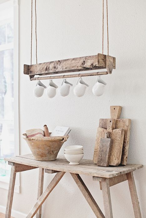 Antique wood tool box turned upside down and hung as a display or hanger for cups or pitchers. Cute repurpose!